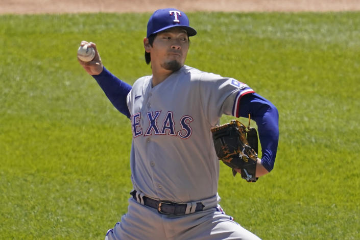 Texas Rangers starting pitcher Kohei Arihara, of Japan, throws against the Chicago White Sox during the first inning of a baseball game in Chicago, Sunday, April 25, 2021. (AP Photo/Nam Y. Huh)