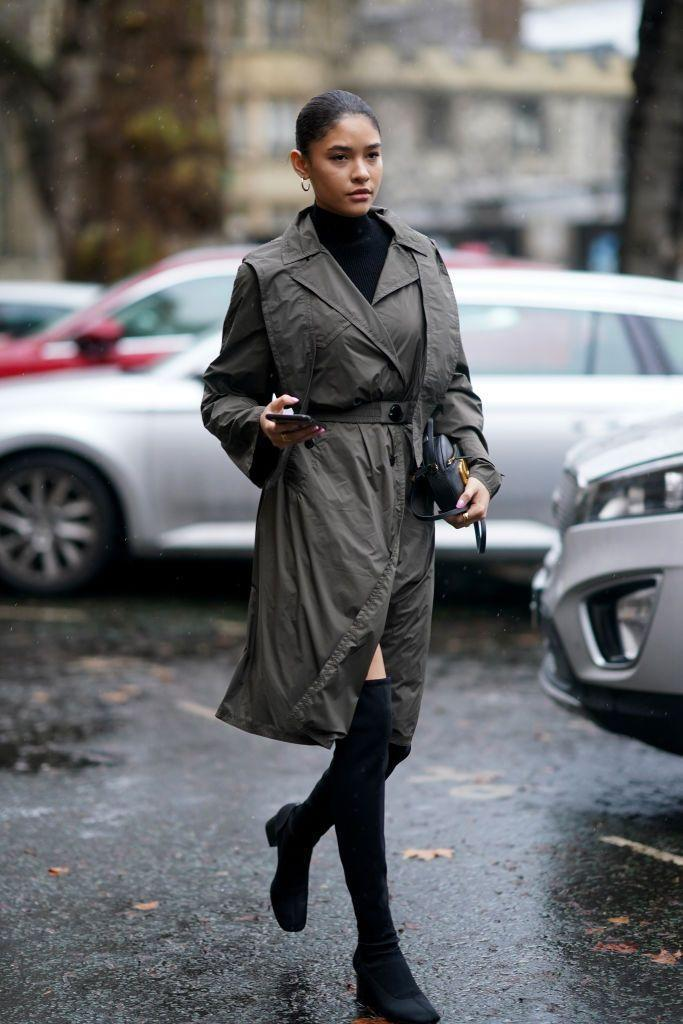 <p>A dark green belted trench over a sleek black turtleneck is undeniably chic. And thigh-high boots with some stretch will really hug your legs if you're not a fan of wide gaps between your skin and the shoe. </p>