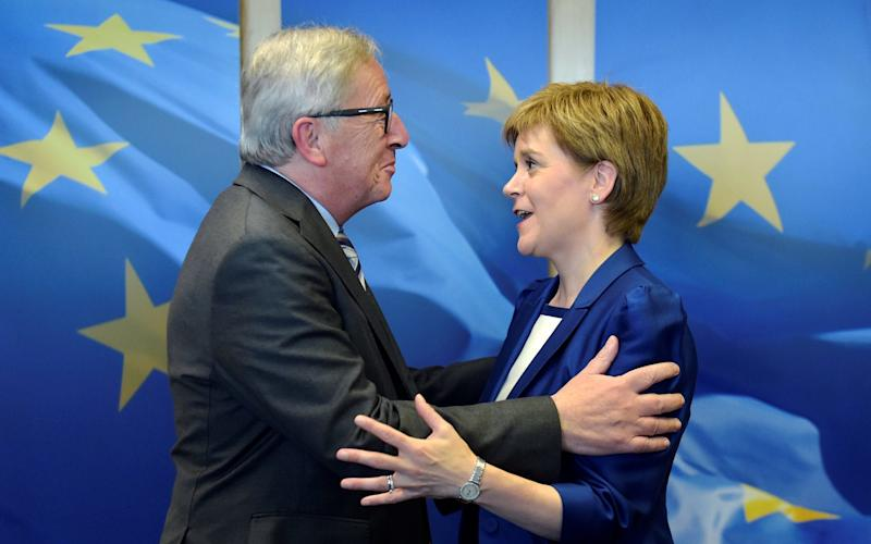 Scotland's First Minister Nicola Sturgeon is welcomed by European Commission President Jean-Claude Juncker on a visit to Brussels last June - Credit: Reuters