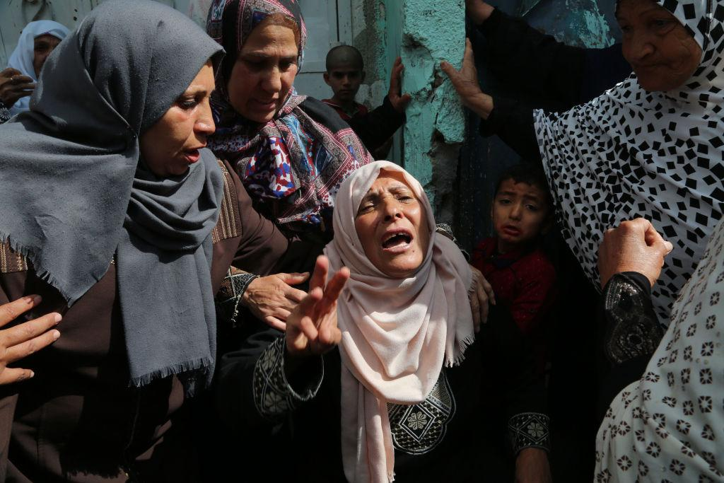 <p>Palestinian relatives of Hamdan Abu Amsha, who was killed a day earlier by Israeli forces when clashes erupted as tens of thousands as Gazans marched near the Israeli border with the enclave to mark Land Day, cry during his funeral in Beit Hanun in the northern of Gaza Strip on March 31, 2018.<br />Sixteen Palestinians were killed and hundreds more wounded in the conflict's worst single day of violence since the 2014 Gaza war. Israel's military targeted three Hamas sites in the Gaza Strip with tank fire and an air strike after what it said was an attempted shooting attack against soldiers along the border that caused no injuries.<br />Protesters, including women and children, gathered at multiple sites throughout the blockaded territory, which is flanked by Israel along its eastern and northern borders. Photo from Majdi Fathi/NurPhoto/Getty Images. </p>