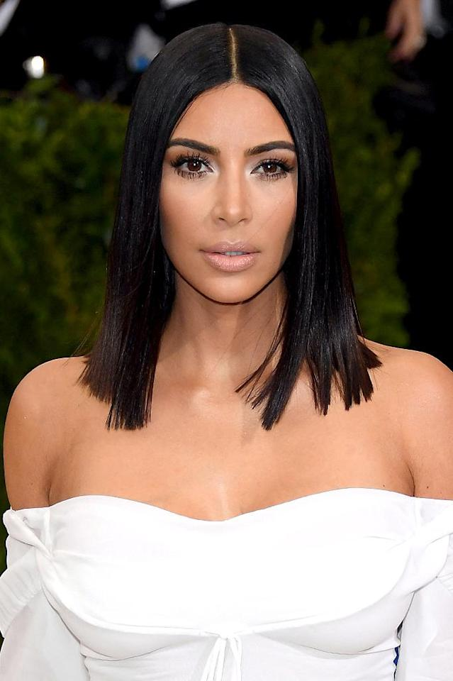 <p>For this year's Met Gala, West gave off Cleopatra vibes while wearing a dark blunt bob cut and frosty highlighted eye makeup. (Photo: Venturelli/WireImage) </p>