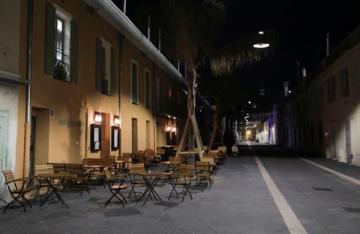 An empty street is seen, as France's Prime Minister announced to close most all non-indispensable locations, notably cafes, restaurants, cinemas, nightclubs and shops from midnight in Nice