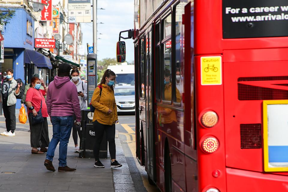 Women wearing face masks board a bus in London. It is mandatory to wear face covering when travelling on London Transport. In the last few days, there has been an increase in the daily number of coronavirus cases and the Prime Minister, Boris Johnson hasn't ruled out a second national lockdown. (Photo by Dinendra Haria / SOPA Images/Sipa USA)