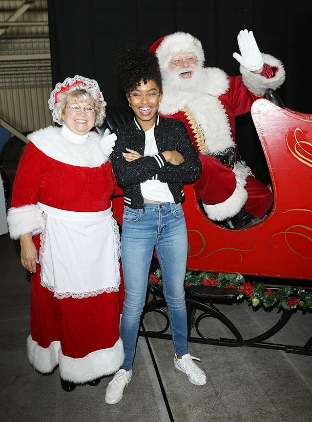 <p>The <em>Black-ish</em> star had a jolly good time hanging out with Santa Claus and the Mrs. at Delta Air Lines' seventh annual Holiday in the Hangar event at Los Angeles International Airport on Wednesday. (Photo: Michael Tran/Getty Images,) </p>