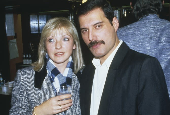 Singer Freddie Mercury (1946 - 1991) of Queen attends Fashion Aid at the Royal Albert Hall in London, with his friend Mary Austin, 5th November 1985. (Photo by Dave Hogan/Getty Images)