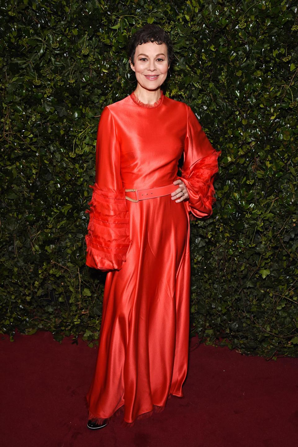 <p>The famous British star stood out in a voluminous satin red dress. <i>[Photo: Getty]</i> </p>