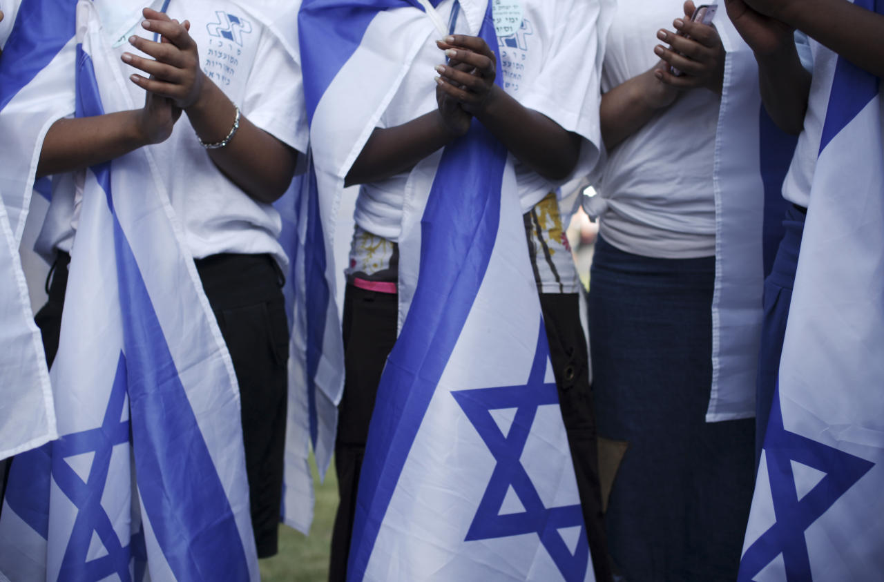 Ethiopian Israeli Jews sing before an agricultural parade celebrating Jerusalem, in downtown Jerusalem, Monday, May 30, 2011.