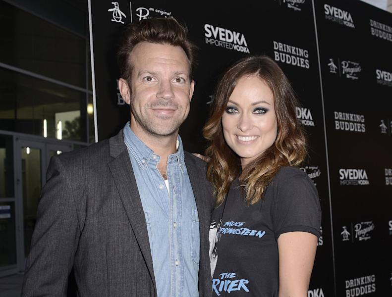 "FILE - In this Thursday, Aug. 15, 2013 file photo, actor Jason Sudeikis and actress Olivia Wilde, arrive on the red carpet at the special screening of the feature film ""Drinking Buddies"" at the ArcLight Hollywood, in Los Angeles. Fashionista Wilde and her comedic fiancé Sudeikis, have been engaged since very early this year but have yet to spill details about their wedding plans--they're too busy. Wilde, who has released two films with one more pending in 2013, spoke to the Associated Press about simply enjoying being engaged, her latest indie comedy, ""Drinking Buddies,"" and addressed rumors she may return for another ""Tron."" (Photo by Dan Steinberg/Invision/AP, File)"
