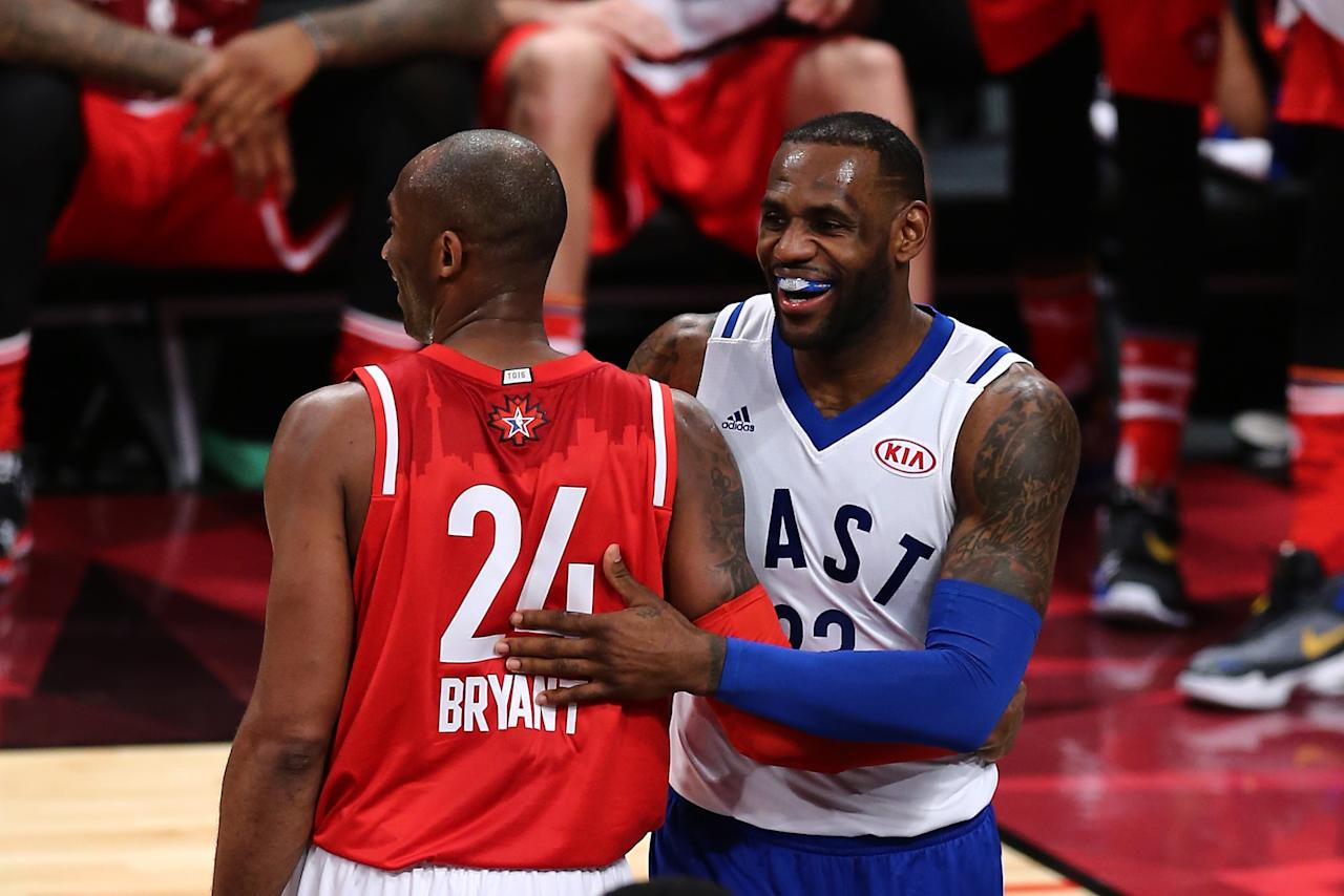TORONTO, ON - FEBRUARY 14: Kobe Bryant #24 of the Los Angeles Lakers and the Western Conference and LeBron James #23 of the Cleveland Cavaliers and the Eastern Conference laugh after a play in the first half during the NBA All-Star Game 2016 at the Air Canada Centre on February 14, 2016 in Toronto, Ontario. NOTE TO USER: User expressly acknowledges and agrees that, by downloading and/or using this Photograph, user is consenting to the terms and conditions of the Getty Images License Agreement.  (Photo by Vaughn Ridley/Getty Images)