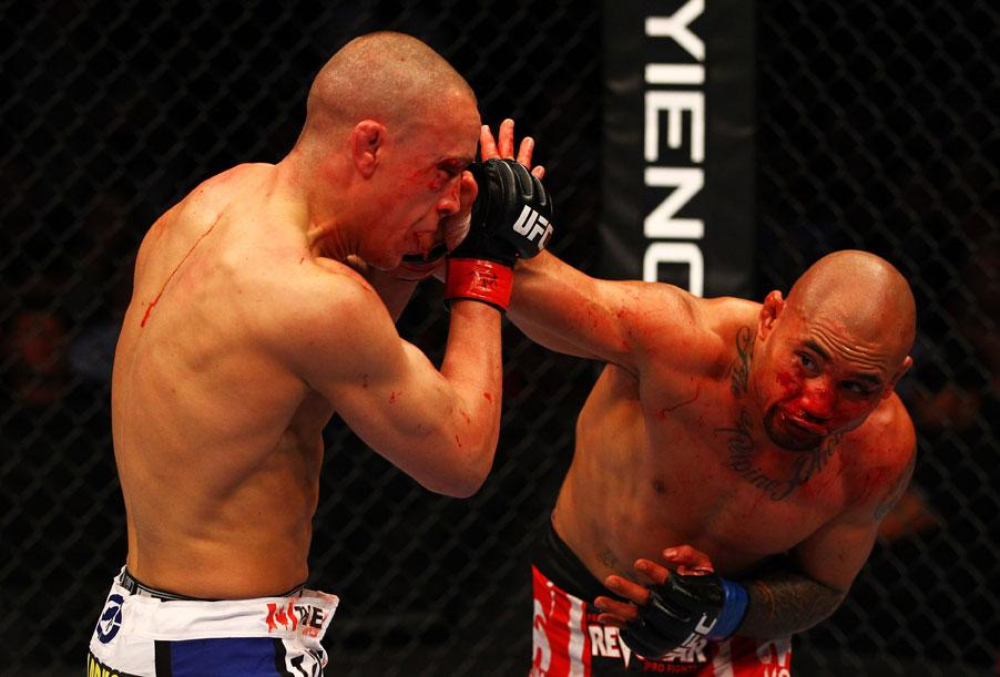 ATLANTA, GA - APRIL 21:  Eddie Yagin (R) punches Mark Hominick during their featherweight bout for UFC 145 at Philips Arena on April 21, 2012 in Atlanta, Georgia.