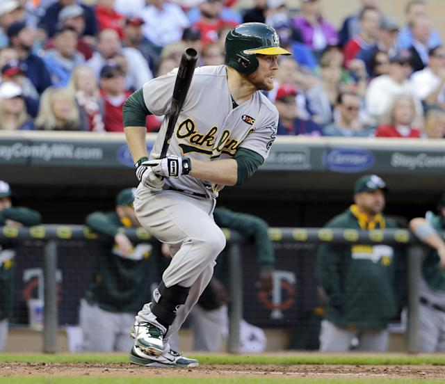 Oakland Athletics first baseman Brandon Moss watches his two-run single off Minnesota Twins starting pitcher Kevin Correia during the third inning of a home opener baseball game in Minneapolis, Monday, April 7, 2014. (AP Photo/Ann Heisenfelt)