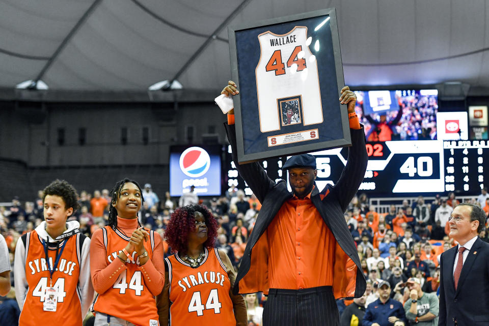 Former Syracuse player John Wallace has his jersey retired during halftime of an NCAA college basketball game between Syracuse and North Carolina in Syracuse, N.Y., Saturday, Feb. 29, 2020. (AP Photo/Adrian Kraus)