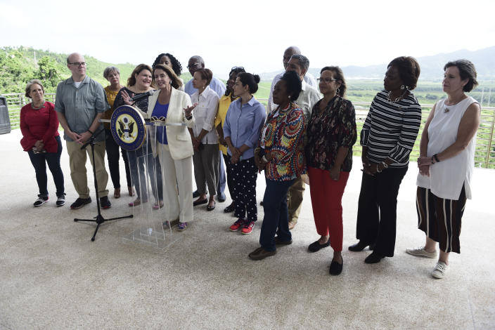 House Democratic Leader Nancy Pelosi speaks at a joint press conference with members of a Congressional delegation, at the Roque Díaz Tizol School in Yabucoa, Puerto Rico, Friday, July 27, 2018. Pelosi is pledging to help speed up Puerto Rico's hurricane recovery process after a two-day visit to the U.S. territory. (AP Photo/Carlos Giusti)