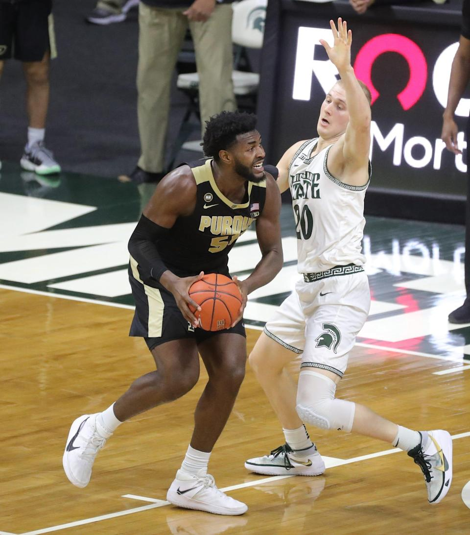 Michigan State Spartans forward Joey Hauser defends Purdue Boilermakers forward Trevion Williams during the second half at Breslin Center in East Lansing, Friday, Jan. 8, 2021.