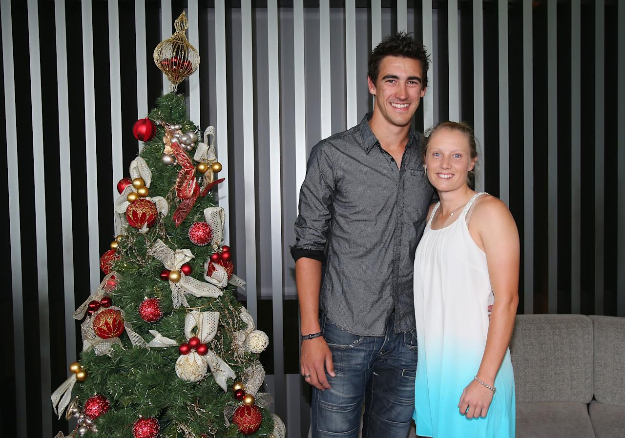MELBOURNE, AUSTRALIA - DECEMBER 25:  Mitchell Starc and girlfriend Alyssa Healy pose next to a Christmas tree ahead of a Cricket Australia Christmas Day lunch at Crown Entertainment Complex on December 25, 2012 in Melbourne, Australia.  (Photo by Scott Barbour/Getty Images)