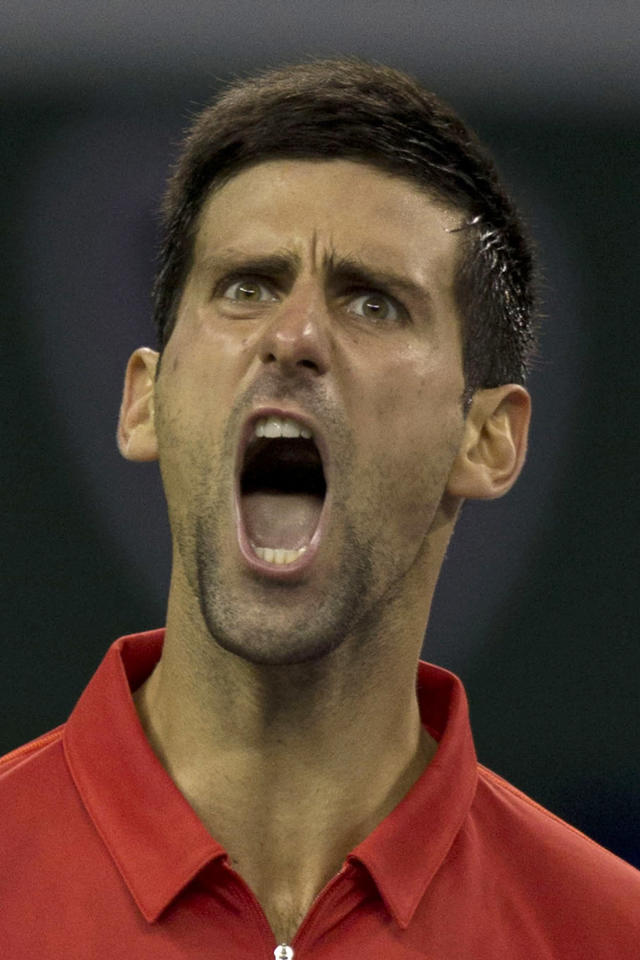 Serbia's Novak Djokovic celebrates a point against France's Gael Monfils during the singles quarterfinal match of the Shanghai Masters tennis tournament at Qizhong Forest Sports City Tennis Center, in Shanghai, China, Friday, Oct. 11, 2013. Djokovic won 6-7, 6-2, 6-4. (AP Photo/Ng Han Guan)