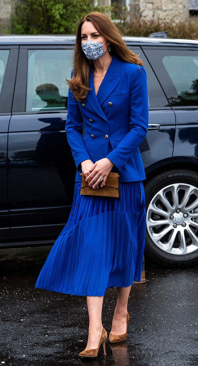 <p>Aaand here's Kate wearing a 2021 spin on the look for the Duke and Duchess of Cambridge's recent visit to Prestonpans. Here, Kate steps out in a shorter blazer, subtle two-toned midi skirt and accessorises the look with brown suede heels and a matching clutch bag.</p>