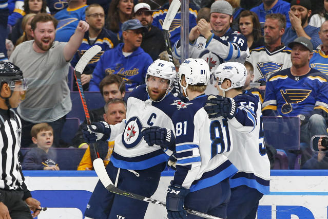 Winnipeg Jets' Blake Wheeler, left, is congratulated by Kyle Connor and Mark Scheifele, right, after scoring a goal against the St. Louis Blues during the first period of an NHL hockey game Friday, Feb. 23, 2018, in St. Louis. (AP Photo/Billy Hurst)