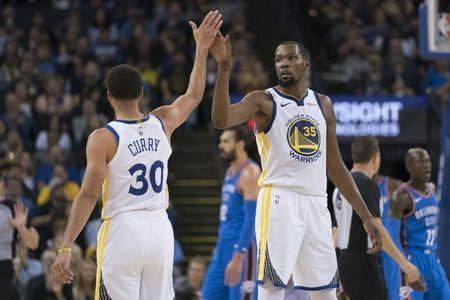 October 16, 2018; Oakland, CA, USA; Golden State Warriors forward Kevin Durant (35) high-fives guard Stephen Curry (30) against the Oklahoma City Thunder during the third quarter at Oracle Arena. Mandatory Credit: Kyle Terada-USA TODAY Sports
