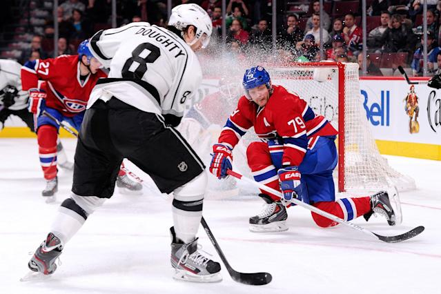 MONTREAL, QC - DECEMBER 10: Andrei Markov #79 of the Montreal Canadiens gets down to block a shot by Drew Doughty #8 of the Los Angeles Kings during the NHL game at the Bell Centre on December 10, 2013 in Montreal, Quebec, Canada. The Kings defeated the Canadiens 6-0. (Photo by Richard Wolowicz/Getty Images)