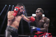 Jermall Charlo, right, fights Juan Macias Montiel during a WBC middleweight world championship boxing match Saturday, June 19, 2021, in Houston. Charlo won the fight. (AP Photo/David J. Phillip)