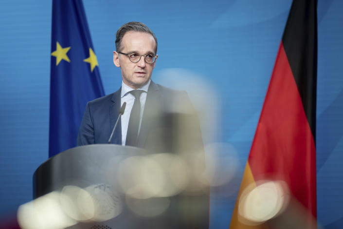 Heiko Maas, German Foreign Minister, gives a press conference on the informal virtual meeting on the informal virtual meeting of the foreign ministers of the member states of the Vienna nuclear agreement in Berlin, Germany, Monday, Dec. 21, 2020. (Kay Nietfeld/dpa via AP)