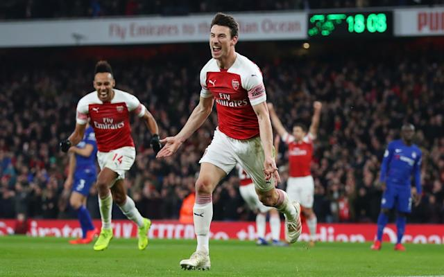 Laurent Koscielny of Arsenal celebrates after scoring his sides second goal during the Premier League match between Arsenal FC and Chelsea - Getty Images Europe