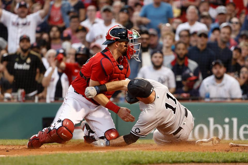 Red Sox catcher Christian Vazquez tags Brett Gardner at the plate trying to score on Sept. 25.
