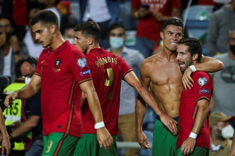 Cristiano Ronaldo (2ndR) became the top scorer in men's international football with two goals against Republic of Ireland last month (AFP/CARLOS COSTA)
