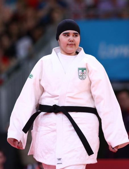 LONDON, ENGLAND - AUGUST 03:  Wojdan Shaherkani of Saudi Arabia (white) competes in the Women's  78 kg Judo on Day 7 of the London 2012 Olympic Games at ExCeL on August 3, 2012 in London, England.  (Photo by Quinn Rooney/Getty Images)