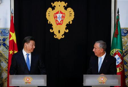 China's President Xi Jinping and Portuguese President Marcelo Rebelo de Sousa hold a news conference in Lisbon, Portugal, December 4, 2018. REUTERS/Pedro Nunes