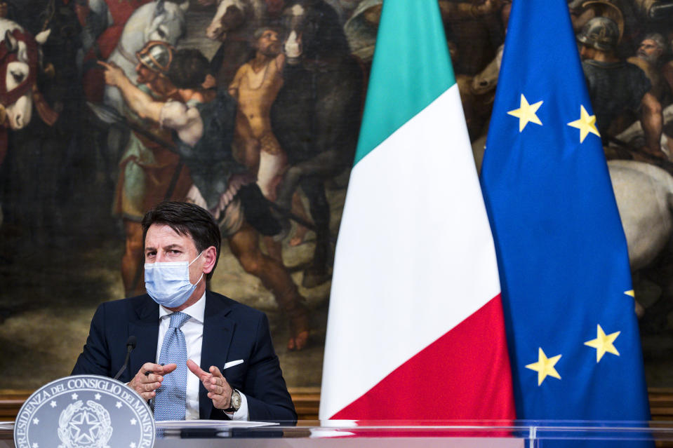 """Italian Premier Giuseppe Conte speaks during a press conference at Chigi Palace government office in Rome, Wednesday, Nov. 4, 2020. Conte announced what he described as """"very stringent"""" restrictions on the so-called """"red zone"""" regions of high risk: Lombardy, Piedmont, Valle d'Aosta in the north, and Calabria, the region forming the """"toe"""" in the south of the Italian peninsula. Four regions in Italy are being put under severe lockdown, forbidding people to leave their homes except for essential reasons such as food shopping and work in a bid to slow surging COVID-19 infections and prevent hospitals from being overwhelmed. (Angelo Carconi ANSA pool/LaPresse via AP)"""