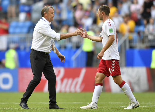 Denmark head coach Age Hareide, left, shakes hand with Henrik Dalsgaard after the group C match between Denmark and Australia at the 2018 soccer World Cup in the Samara Arena in Samara, Russia, Thursday, June 21, 2018. (AP Photo/Martin Meissner)