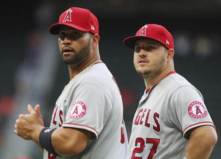 Los Angeles Angels first baseman Albert Pujols (5) and center fielder Mike Trout (27).