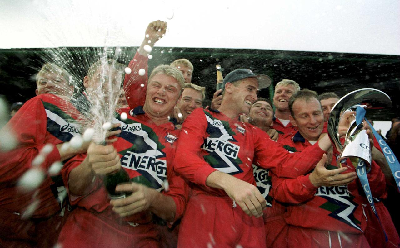 12 Sep 1999:  Andrew Flintoff leads the celebrations The Lancashire team celebrate winning the title after the CGU National Cricket League game between Lancashire Lightning v Kent Spitfires at Lancashire County Cricket Club, Old Trafford, Manchester. Mandatory Credit: Laurence Griffiths/ALLSPORT