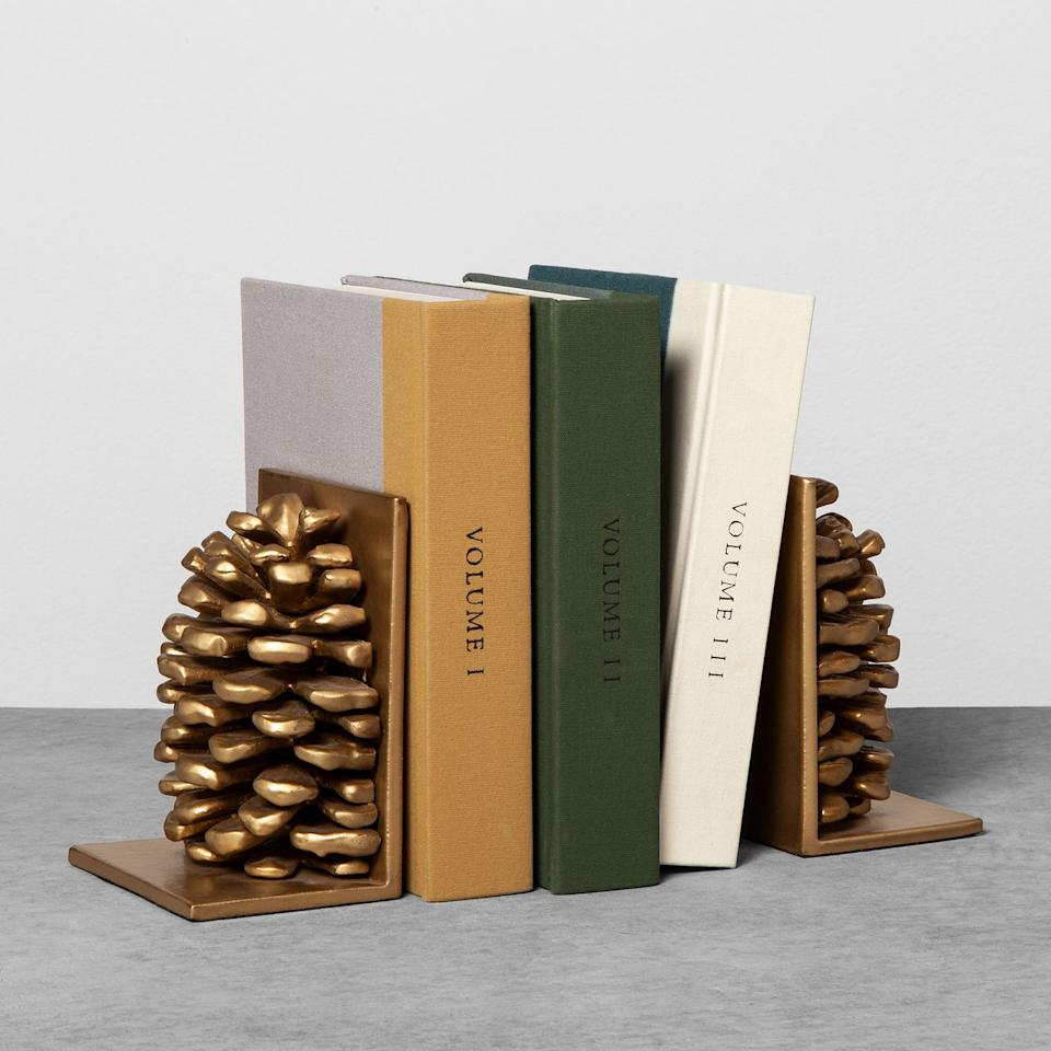 "<p>$35</p><p><a rel=""nofollow"" href=""https://fave.co/2NEKvOK"">SHOP NOW</a></p><p>Our favorite find from this vignette is this pair of gilded pinecones that add just the right amount of autumnal flair to any bookcase.</p>"