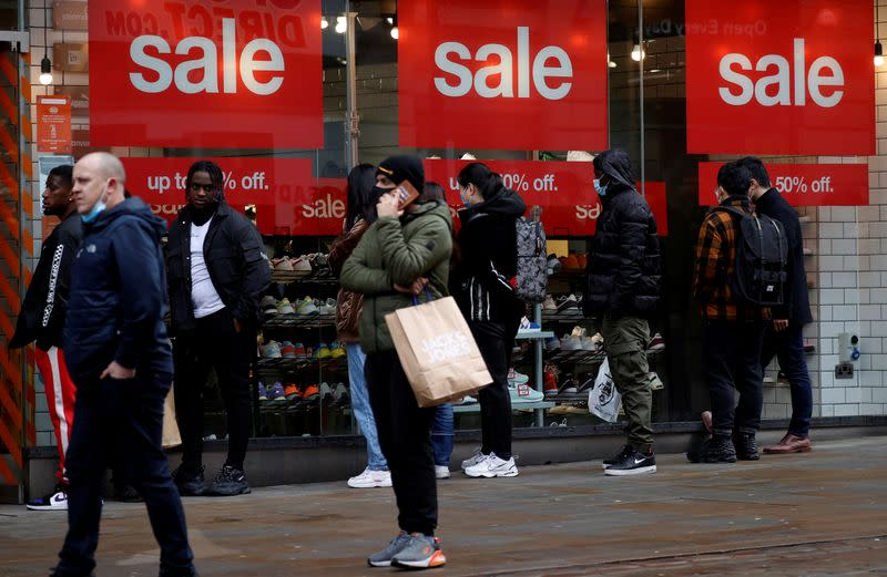 FILE PHOTO: Shoppers queue to enter a shoe shop at the start of the Boxing Day sales amid the outbreak of the coronavirus disease (COVID-19) in Manchester