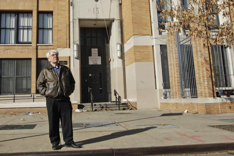In this Dec. 1, 2011 photo, Bronx Household of Faith co-pastor Robert Hall poses for a portrait in front of  P.S. 15 in the Bronx borough of New York. The congregation behind a church-state lawsuit that may become an important Supreme Court case has just 48 official members and doesn't even have office space, never mind a church building. It now holds its services in P.S. 15 and is appealing a ruling that says doing so violates the Constitution. (AP Photo/Mary Altaffer)