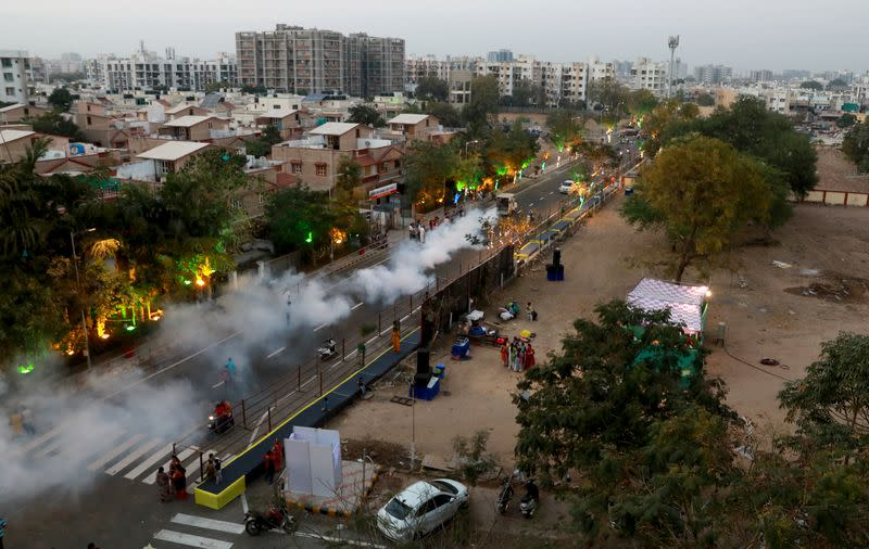 A road is fumigated ahead of the visit of U.S. President Donald Trump, in Ahmedabad