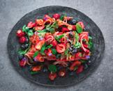 """A Thai-inspired fruit salad that's cooling and spicy. This is the perfect side dish for whatever you're grilling. <a href=""""https://www.epicurious.com/recipes/food/views/watermelon-berry-salad-with-chile-dressing-and-lots-of-herbs-gregory-gourdet-everyones-table?mbid=synd_yahoo_rss"""" rel=""""nofollow noopener"""" target=""""_blank"""" data-ylk=""""slk:See recipe."""" class=""""link rapid-noclick-resp"""">See recipe.</a>"""