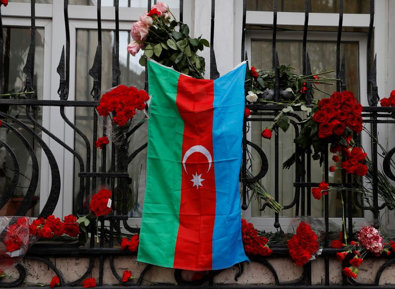 The national flag of Azerbaijan hangs at a makeshift memorial for people killed in the country during the military conflict over the breakaway region of Nagorno-Karabakh, in Moscow