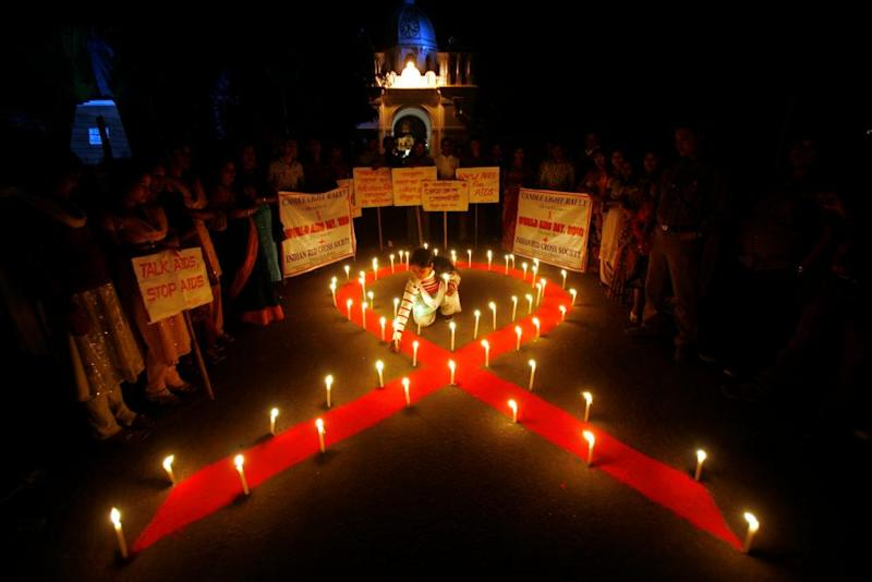 Activists in Agartala, in the Indian state of Tripura, light candles as part of an Aids awareness campaign