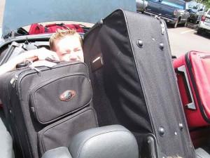 Boy buried in luggage