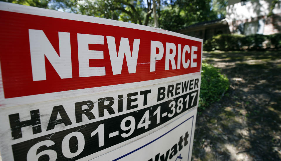 """In this June 13, 2019, photo a house on the market has a """"new price"""" sign fixed on the realtor's sign in northeast Jackson, Miss. On Tuesday, June 25, the Standard & Poor's/Case-Shiller 20-city home price index for April is released. (AP Photo/Rogelio V. Solis)"""