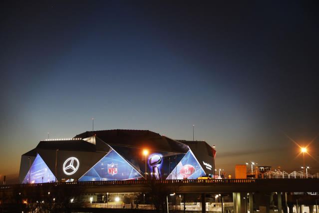 The sun sets behind Mercedes-Benz Stadium ahead of Sunday's NFL Super Bowl 53 football game between the Los Angeles Rams and New England Patriots in Atlanta, Wednesday, Jan. 30, 2019. (AP Photo/David Goldman)