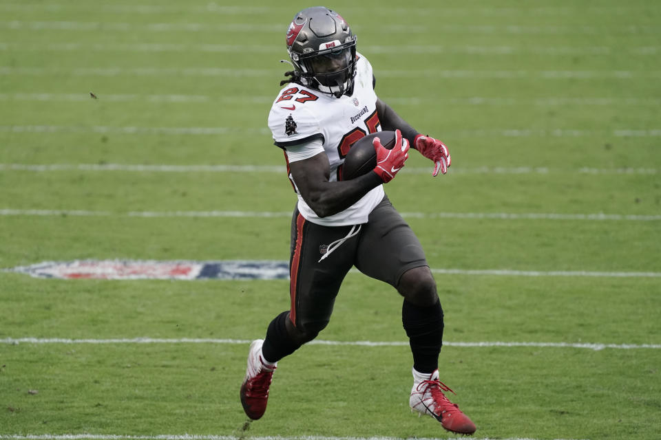 Tampa Bay Buccaneers running back Ronald Jones runs against the Carolina Panthers during an NFL game.