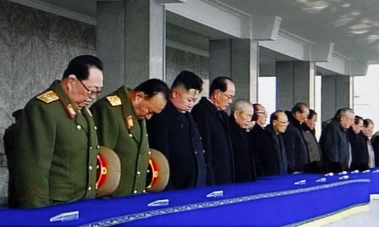 "In this image made from KRT video, North Korea's next leader Kim Jong Un, 3rd left, and ceremonial head of state Kim Yong Nam, 4th left, bow their head to take a moment of silence during a memorial service for late North Korean leader Kim Jong Il, in Pyongyang, North Korea, Thursday, Dec. 29, 2011. Kim Jong Un, Kim Jong Il's son and successor, was declared ""supreme leader"" of North Korea's ruling party, military and the people during a memorial Thursday for his father in the first public endorsement of his leadership by the government. (AP Photo/KRT via APTN) TV OUT, NORTH KOREA OUT"