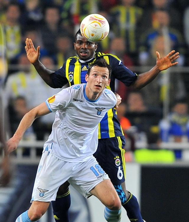 Fenerbahce's Joseph Yobo (back) vies with Lazio's Libor Kozak during their UEFA Europa League quarter-final match between at Sukru Saracoglu Stadium in Istanbul on April 4, 2013. AFP PHOTO/BULENT KILICBULENT KILIC/AFP/Getty Images
