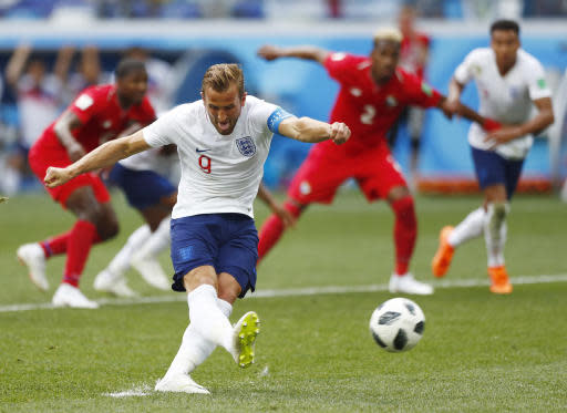 England's Harry Kane kicks a penalty to score his team's second goal during the group G match between England and Panama at the 2018 soccer World Cup at the Nizhny Novgorod Stadium in Nizhny Novgorod , Russia, Sunday, June 24, 2018. (AP Photo/Matthias Schrader)
