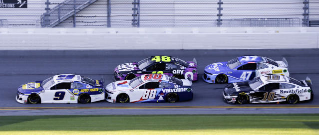 Chase Elliott (9), Alex Bowman (88), Jimmie Johnson (48), Ricky Stenhouse Jr. (47) and Aric Almirola (10) race down the front stretch during the NASCAR Daytona 500 auto race at Daytona International Speedway, Monday, Feb. 17, 2020, in Daytona Beach, Fla. Sunday's race was postponed because of rain. (AP Photo/Terry Renna)